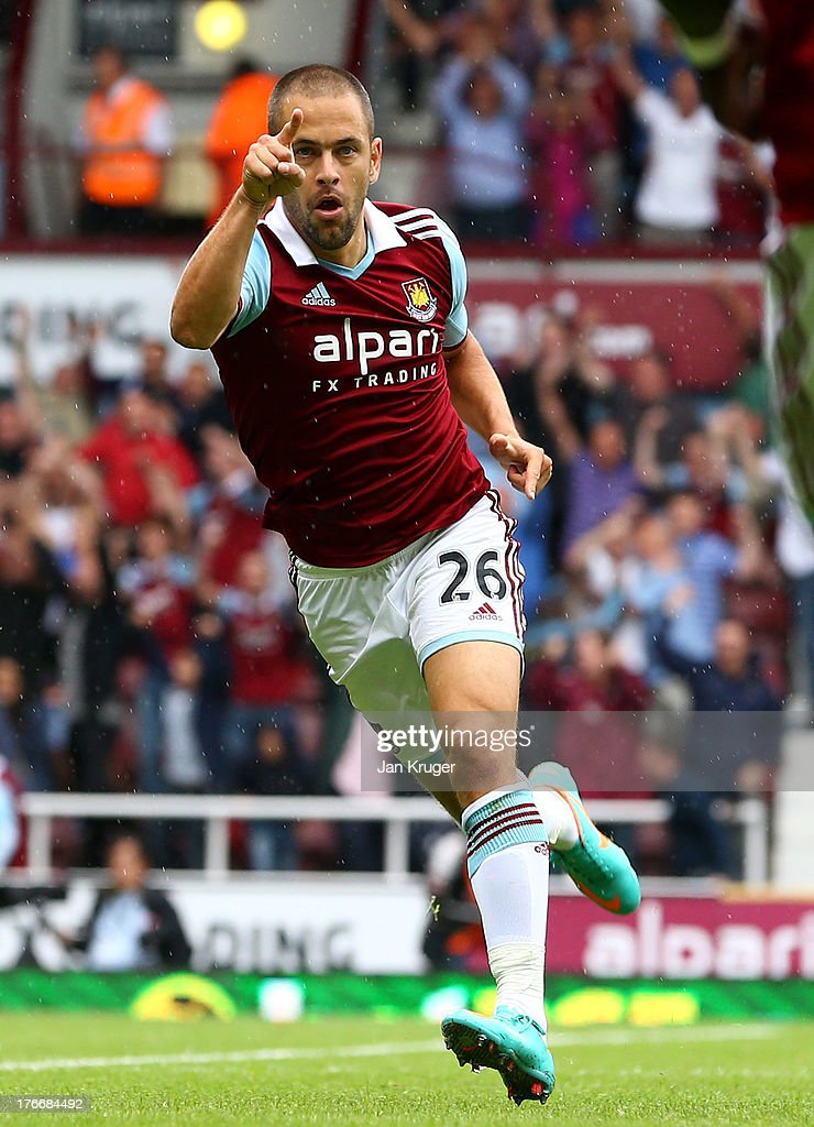 <a gi-track='captionPersonalityLinkClicked' href=/galleries/search?phrase=Joe+Cole&family=editorial&specificpeople=171525 ng-click='$event.stopPropagation()'>Joe Cole</a> of West Ham United celebrates his goal during the Barclays Premier League match between West Ham United and Cardiff City at the Bolyen Ground on August 17, 2013 in London, England.