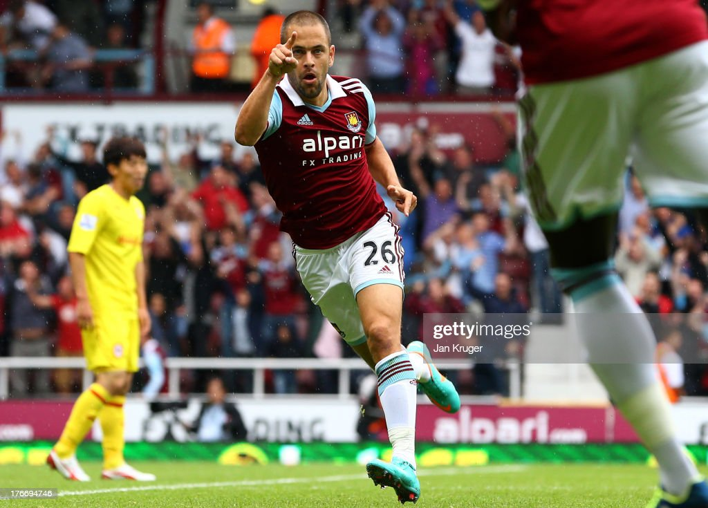 Joe Cole of West Ham United celebrates his goal during the Barclays Premier League match between West Ham United and Cardiff City at the Bolyen Ground on August 17, 2013 in London, England.