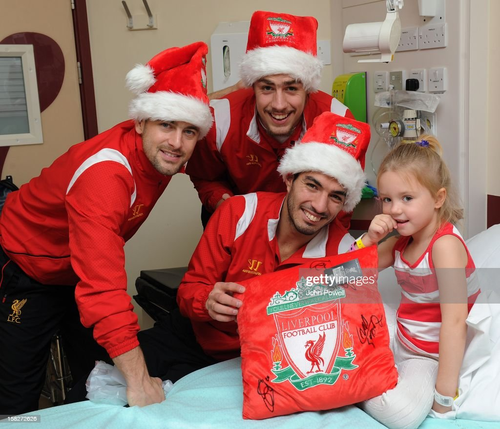 Joe Cole, Sebastian Coates and Luis Suarez of Liverpool FC visit Alder Hey Children's Hospital on December 12, 2012 in Liverpool, England.