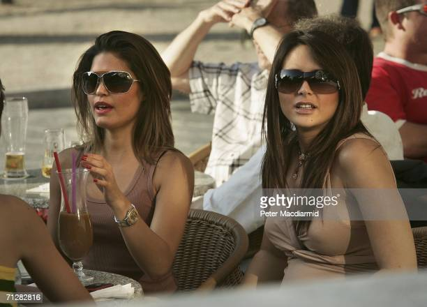 23 Joe Cole's girlfriend Carly Zucker and Wayne Bridge's girlfriend Vanessa Perroncel enjoy a drink at a cafe on June 23 2006 in BadenBaden Germany...