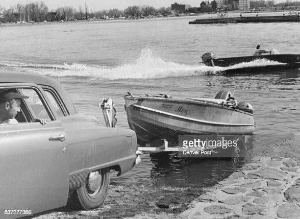 Joe Cook of 1046 Adams St guides his boat trailer down the beach into the water looking forward to an afternoon of sport Cook's boat is equipped with...