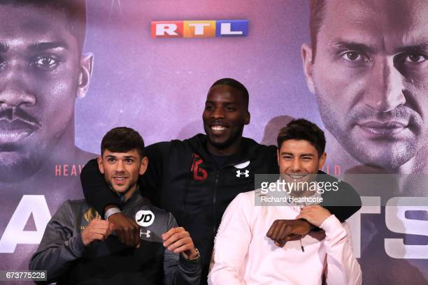 Joe Cordina and Joshua Kelly pose for photos with Lawrence Okolie prior to their fight as Anthony Joshua and Wladamir Klitschko take part in a press...