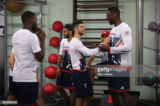 Joe Cordina and Lawrence Okolie of Great Britain share a joke during a Team GB Boxing media access session at Minas Tennis Clube on July 29 2016 in...
