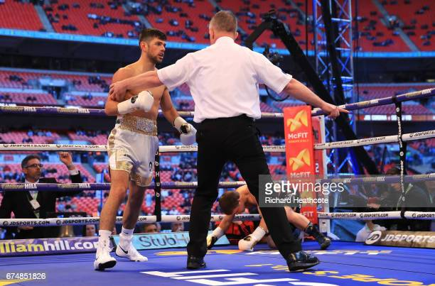 Joe Cordina defeats Sergej Vib in the first round of the Super Featherweight bout at Wembley Stadium on April 29 2017 in London England
