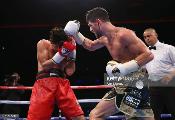 Joe Cordina throws a right shot on Jose Aguilar during the SuperFeatherweight contest between Joe Cordina and Jose Aguilar at Echo Arena on April 22...