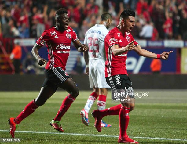 Joe Corona celebrates his score the first of his team with Aviles Hurtado during the 15th round match between Tijuana and Toluca as part of the...
