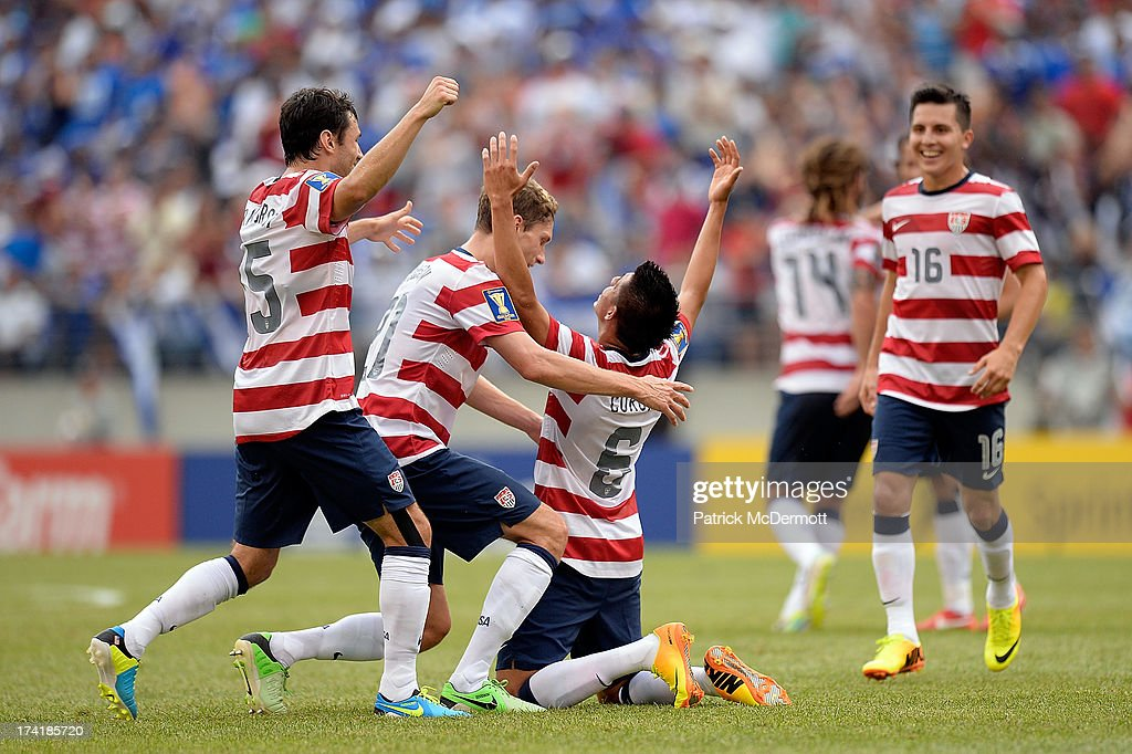 Joe Corona #6 of the United States celebrates with his teammates after scoring a goal in the first half against El Salvador during the 2013 CONCACAF Gold Cup quarterfinal game at M&T Bank Stadium on July 21, 2013 in Baltimore, Maryland.