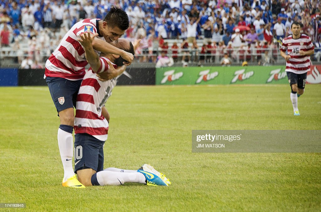 Joe Corona (L) of the US hugs Landon Donovan (C) after Donovan scored a goal in the second half during a CONCACAF quarterfinal match in Baltimore on July 21, 2013.