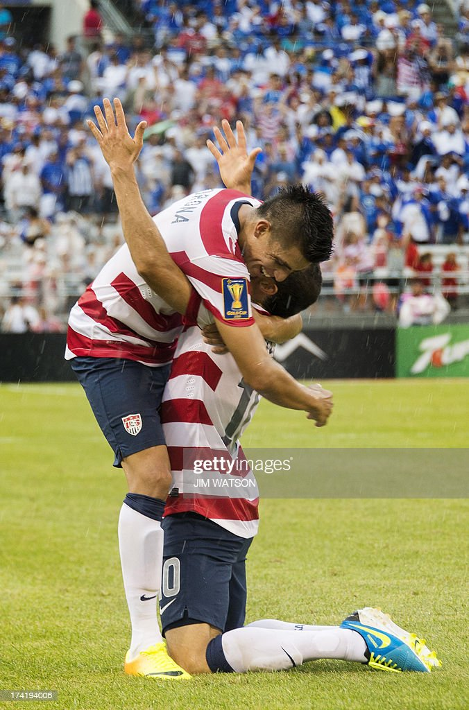 Joe Corona (R) of the US hugs Landon Donovan (L) after Donovan scored a goal in the second half during a CONCACAF Gold Cup quarterfinal match in Baltimore on July 21, 2013.