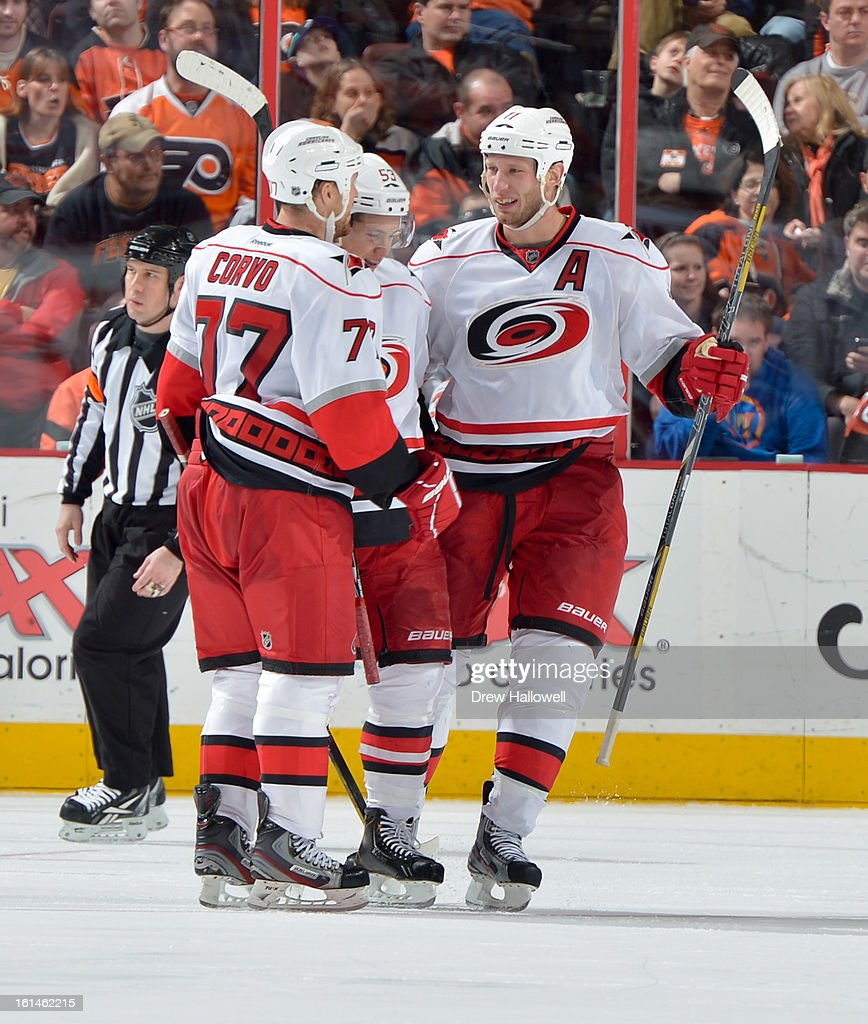 Joe Corvo #77, Jeff Skinner #53 and Jordan Staal #11 of the Carolina Hurricanes celebrate a goal during the game against the Philadelphia Flyers at the Wells Fargo Center on February 9, 2013 in Philadelphia, Pennsylvania.
