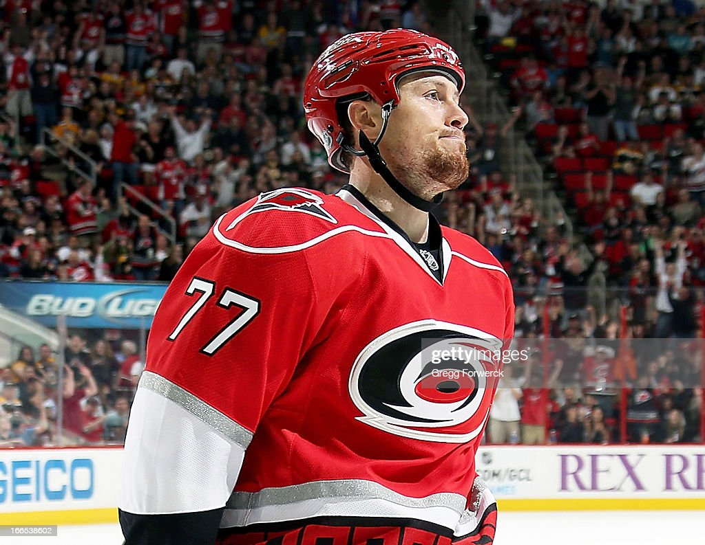 <a gi-track='captionPersonalityLinkClicked' href=/galleries/search?phrase=Joe+Corvo&family=editorial&specificpeople=206339 ng-click='$event.stopPropagation()'>Joe Corvo</a> #77 of the Carolina Hurricanes acknowledges the crowd folowing his third-period goal against the Boston Bruins, the eventual game-winning goal, during their NHL game at PNC Arena on April 13, 2013 in Raleigh, North Carolina.