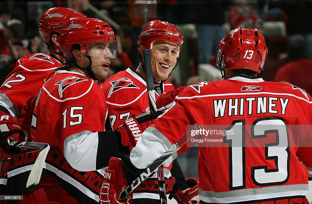 Joe Corvo of the Carolina Hurricanes celebrates his first period goal with teammates Eric Staal Tuomo Ruutu and Ray Whitney during a NHL game against...