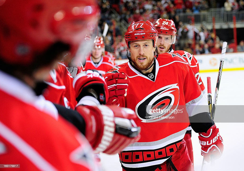 Joe Corvo #77 of the Carolina Hurricanes celebrates with teammates after scoring a goal against the Buffalo Sabres during play at PNC Arena on March 5, 2013 in Raleigh, North Carolina.