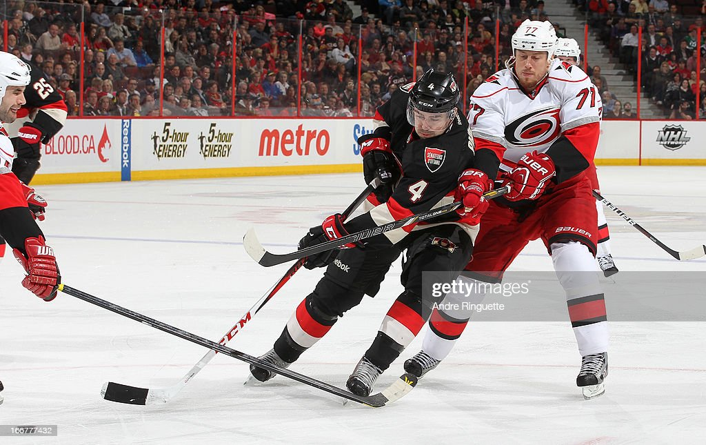 <a gi-track='captionPersonalityLinkClicked' href=/galleries/search?phrase=Joe+Corvo&family=editorial&specificpeople=206339 ng-click='$event.stopPropagation()'>Joe Corvo</a> #77 of the Carolina Hurricanes defends against Chris Phillips #4 of the Ottawa Senators on April 16, 2013 at Scotiabank Place in Ottawa, Ontario, Canada.