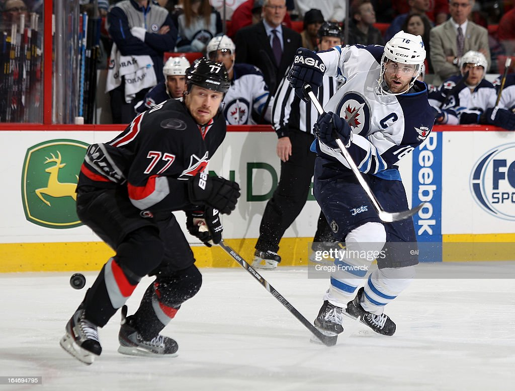 <a gi-track='captionPersonalityLinkClicked' href=/galleries/search?phrase=Joe+Corvo&family=editorial&specificpeople=206339 ng-click='$event.stopPropagation()'>Joe Corvo</a> #77 of the Carolina Hurricanes steps in front of a shot from <a gi-track='captionPersonalityLinkClicked' href=/galleries/search?phrase=Andrew+Ladd&family=editorial&specificpeople=228452 ng-click='$event.stopPropagation()'>Andrew Ladd</a> #16 of the Winnipeg Jets during their NHL game at PNC Arena on March 26, 2013 in Raleigh, North Carolina.