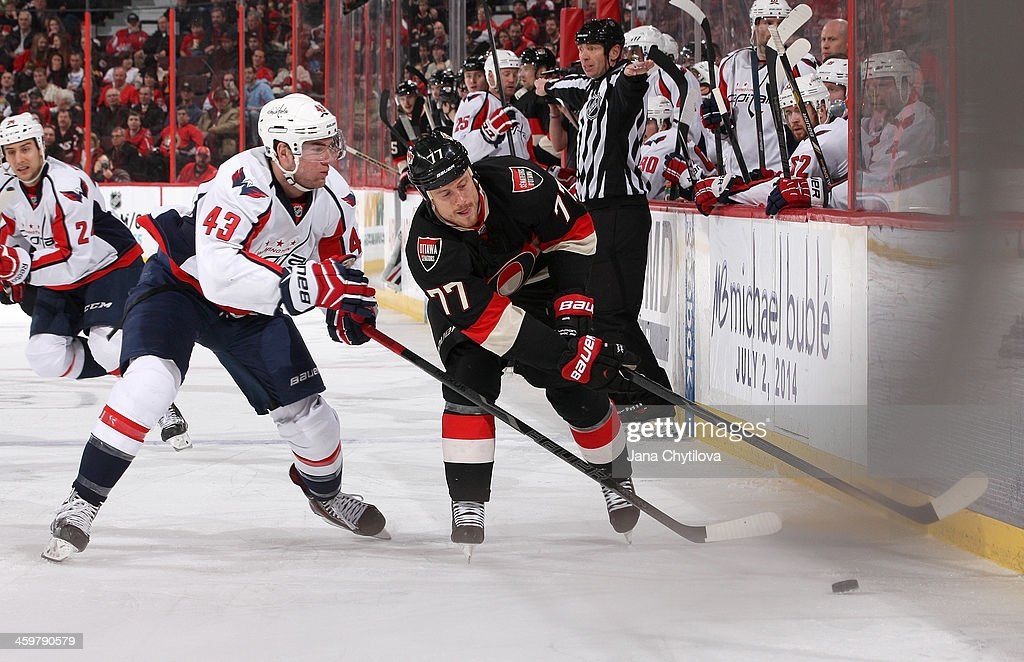 <a gi-track='captionPersonalityLinkClicked' href=/galleries/search?phrase=Joe+Corvo&family=editorial&specificpeople=206339 ng-click='$event.stopPropagation()'>Joe Corvo</a> #77 of the Ottawa Senators carries the puck into the offensive zone against Tom Wilson #43 of the Washington Capitals during an NHL game at Canadian Tire Centre on December 30, 2013 in Ottawa, Ontario, Canada.