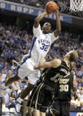 Joe Crawford of the Kentucky Wildcats shoots the ball while defended by Kenrick Zondervan of the Central Florida Golden Knights during the Kentucky...