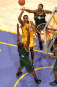 Joe Crawford of the Los Angeles DFenders attempts a shot between Dave Noel and Damone Brown of the Reno Bighorns at Staples Center on November 30...