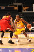 Joe Crawford of the Los Angeles DFenders drives against Jeremy Kelly of the Tulsa 66ers at Staples Center on December 7 2008 in Los Angeles...