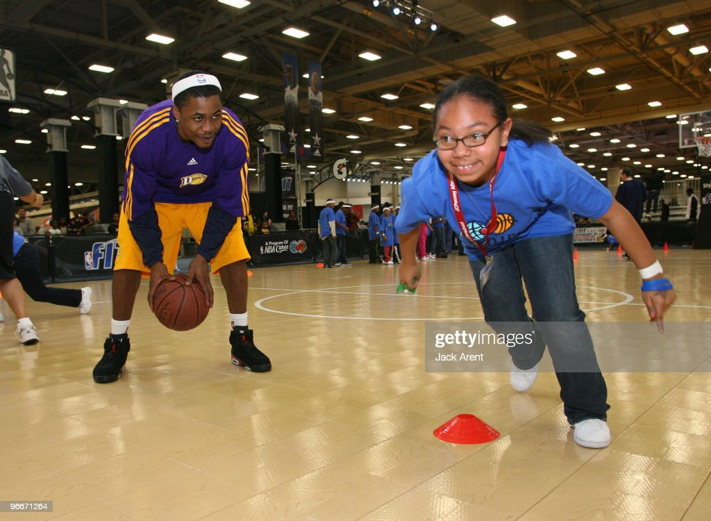 Joe Crawford of the Los Angeles DFenders encourages a participant during the Gatorade basketball clinic during Jam Session presented by Adidas during...
