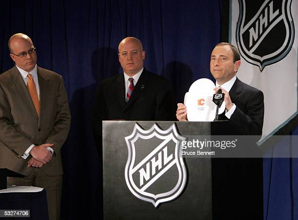 Joe Crotty of Ernst Young Executive Vice President Bill Daly and Commissioner Gary Bettman of the National Hockey League announce the Calgary Flames...