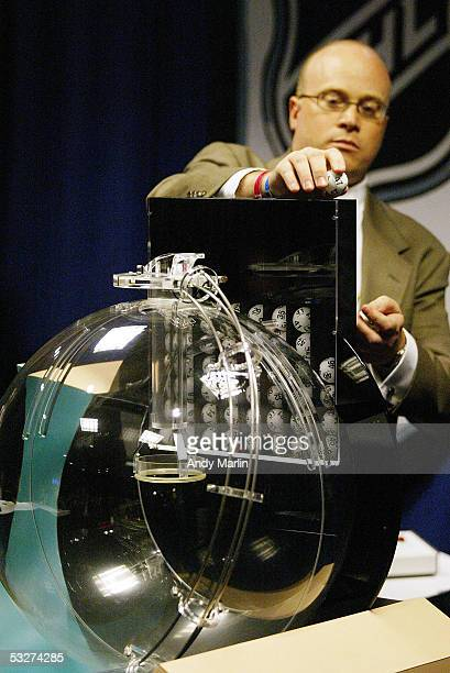 Joe Crotty of the Ernst Young accounting firm makes the ball selection during the NHL draft lottery at the Sheraton New York Hotel and Towers on July...