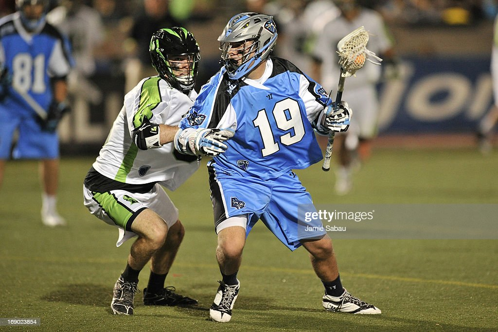Joe Cummings #19 of the Ohio Machine controls the ball as David Earl #33 of the New York Lizards defends in the third period on May 18, 2013 at Selby Stadium in Delaware, Ohio. New York defeated Ohio 14-8.