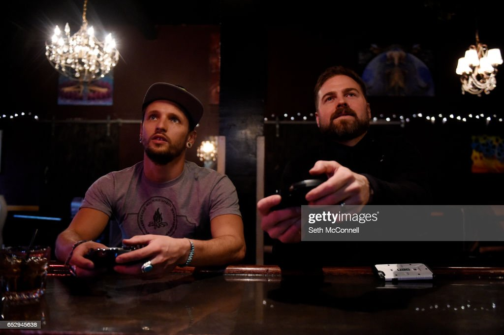 Joe Dan Hite, left, and Jesse Livermore play video games at the bar at Your Mom's House on March 9, 2017 in Denver, Colorado. Your Mom's House is Denver's newest concert venue with a full menu of wine and spirits.