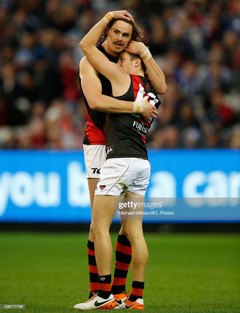 Joe Daniher (left) and Orazio Fantasia of the Bombers celebrate during the 2016 AFL Round 06 match between the Carlton Blues and the Essendon Bombers at the Melbourne Cricket Ground, Melbourne on May 1, 2016.