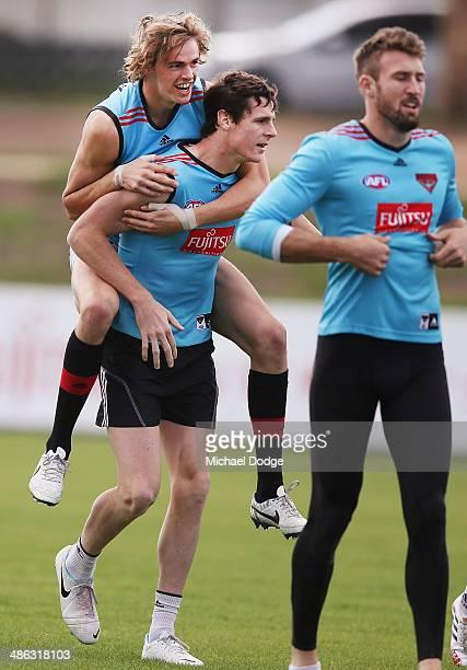 Joe Daniher jumps on Jake Carlile during an Essendon Bombers AFL training session at True Value Solar Centre on April 24 2014 in Melbourne Australia