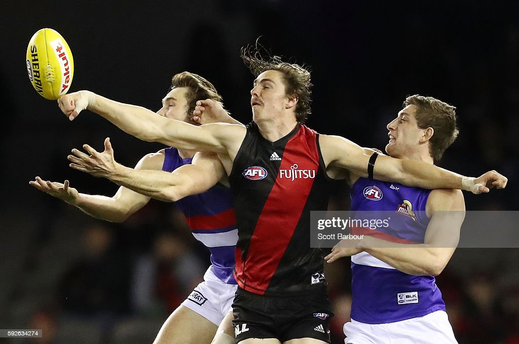 Joe Daniher of the Bombers and Joel Hamling of the Bulldogs and Fletcher Roberts of the Bulldogs ccompete for the ball during the round 22 AFL match...