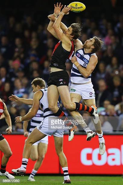 Joe Daniher of the Bombers and Tom Lonergan of the Cats compete for the ball during the round 20 AFL match between the Geelong Cats and the Essendon...