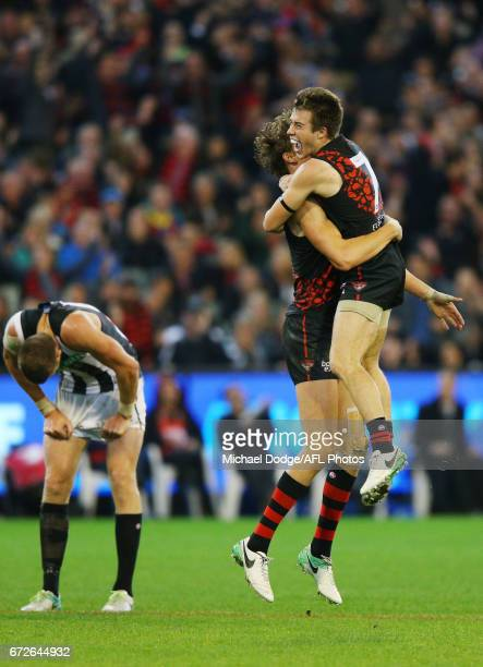 Joe Daniher of the Bombers celebrates a goal with Zach Merrett during the round five AFL match between the Essendon Bombers and the Collingwood...