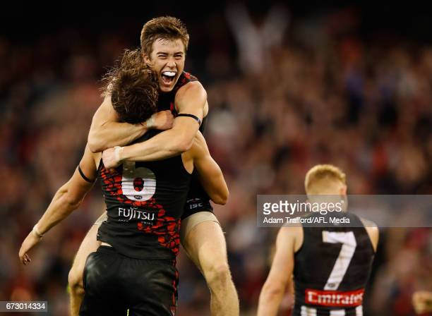 Joe Daniher of the Bombers celebrates a goal with Zach Merrett of the Bombers during the 2017 AFL round 05 ANZAC Day match between the Essendon...
