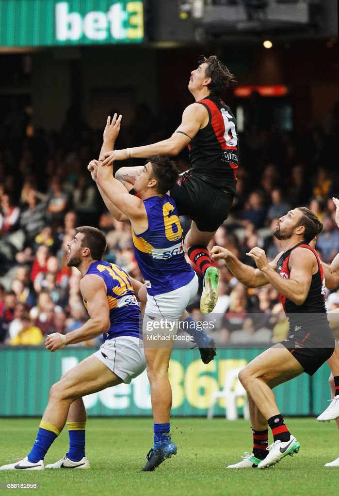 Joe Daniher of the Bombers compete for the ball over Elliot Yeo of the Eagles during the round nine AFL match between the Essendon Bombers and the West Coast Eagles at Etihad Stadium on May 21, 2017 in Melbourne, Australia.