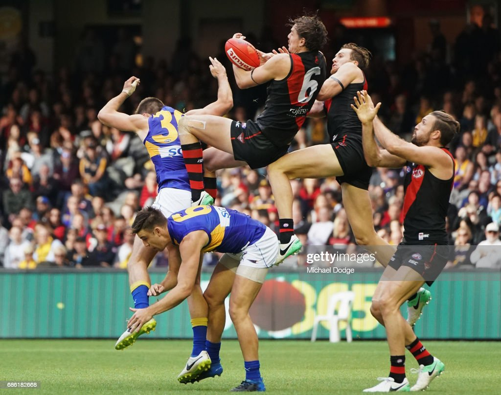 Joe Daniher of the Bombers competes for the ball over Elliot Yeo of the Eagles during the round nine AFL match between the Essendon Bombers and the West Coast Eagles at Etihad Stadium on May 21, 2017 in Melbourne, Australia.