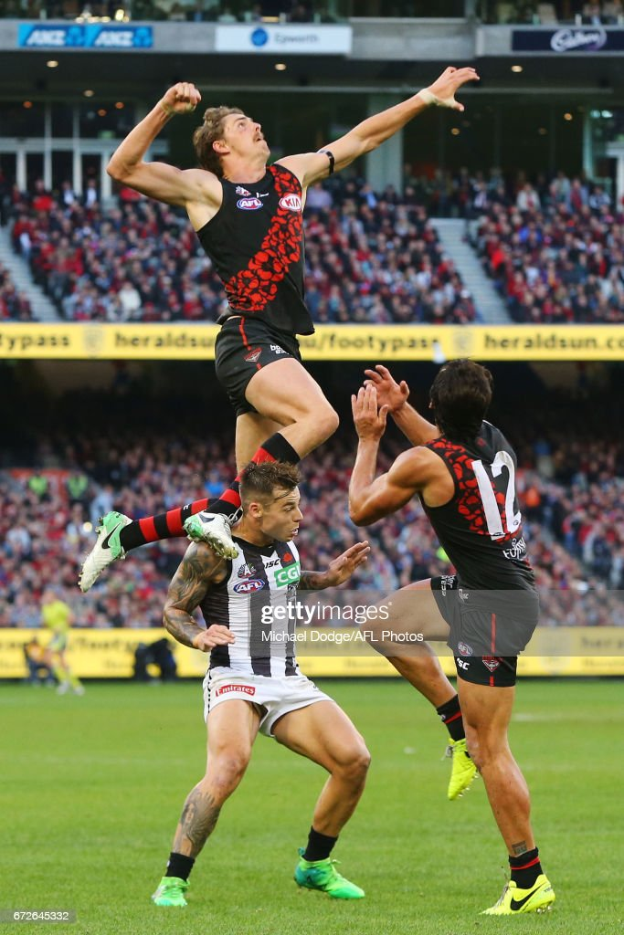 Joe Daniher of the Bombers competes for the ball over Jamie Elliott of the Magpies during the round five AFL match between the Essendon Bombers and the Collingwood Magpies at Melbourne Cricket Ground on April 25, 2017 in Melbourne, Australia.