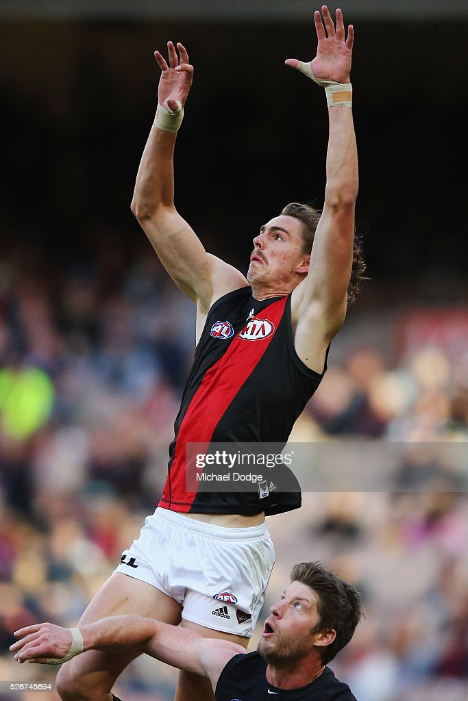 Joe Daniher of the Bombers competes for the ball over Sam Rowe of the Blues during the round six AFL match between the Carlton Blues and the Essendon Bombers at Melbourne Cricket Ground on May 1, 2016 in Melbourne, Australia.