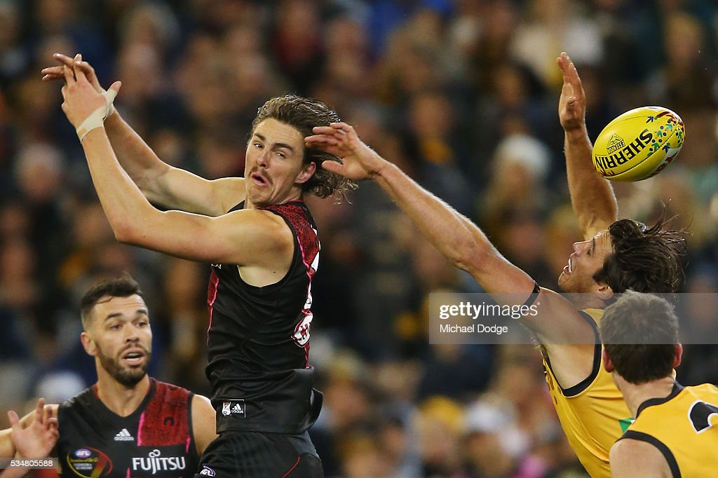 Joe Daniher of the Bombers (L) drops a mark ahead of Alex Rance of the Tigers during the round 10 AFL match between the Essendon Bombers and the Richmond Tigers at Melbourne Cricket Ground on May 28, 2016 in Melbourne, Australia.