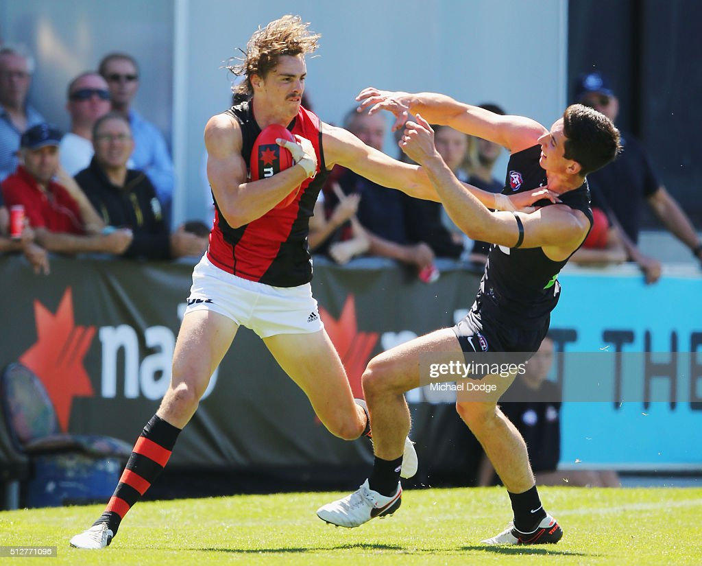 Joe Daniher of the Bombers fends off Jacob Weitering of the Blues during the 2016 AFL NAB Challenge match between Carlton and Essendon at Ikon Park...