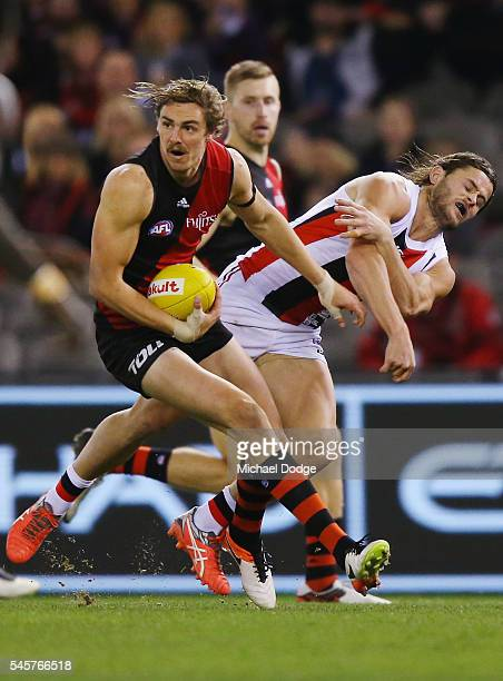 Joe Daniher of the Bombers fends off Maverick Weller of the Saints during the round 16 AFL match between the Essendon Bombers and the St Kilda Saints...