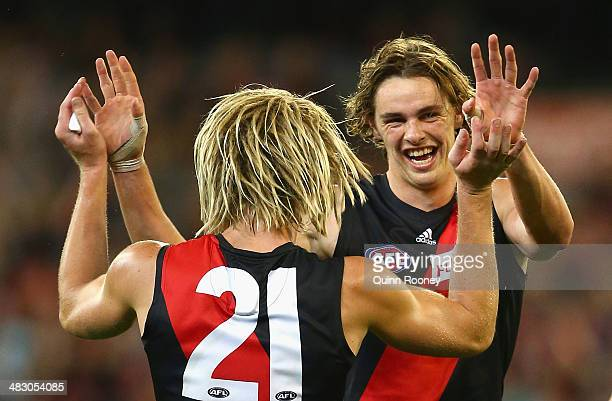 Joe Daniher of the Bombers is congratulated by Dyson Heppell after kicking a goal during the round three AFL match between the Essendon Bombers and...