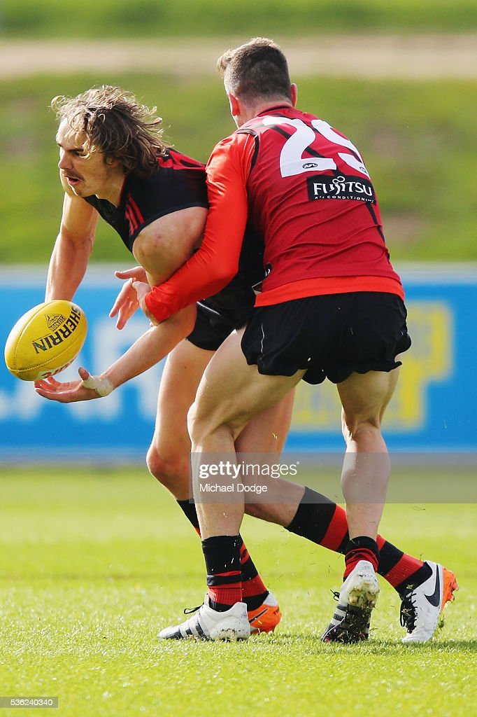 Joe Daniher of the Bombers is tackled by Patrick Ambrose during an Essendon Bombers AFL training session at True Value Solar Centre on June 1, 2016 in Melbourne, Australia.