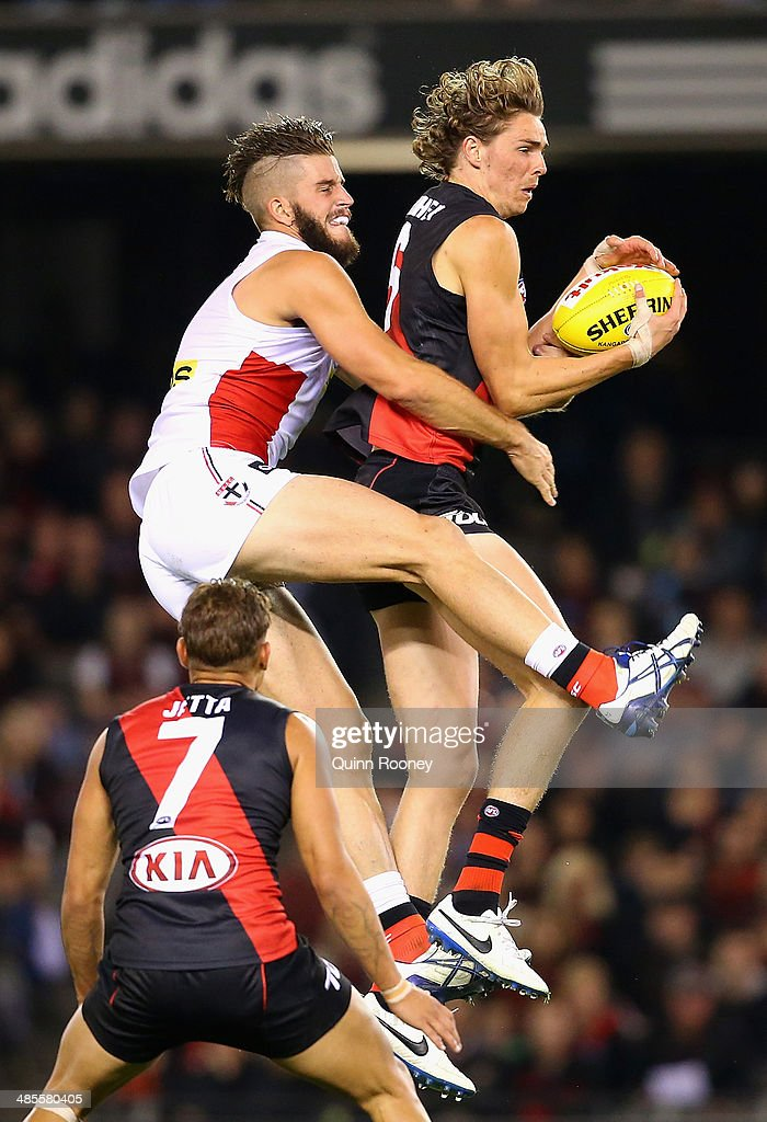 Joe Daniher of the Bombers marks infront of Josh Bruce of the Saints during the round five AFL match between the Essendon Bombers and the St Kilda Saints at Etihad Stadium on April 19, 2014 in Melbourne, Australia.