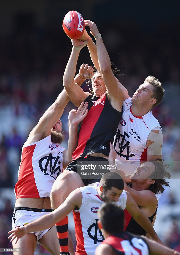 Joe Daniher of the Bombers marks infront of Tom McDonald of the Demons during the round two AFL match between the Essendon Bombers and the Melbourne...