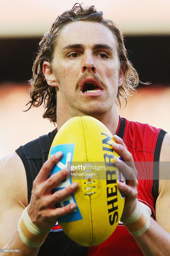 Joe Daniher of the Bombers marks the ball during the round six AFL match between the Carlton Blues and the Essendon Bombers at Melbourne Cricket Ground on May 1, 2016 in Melbourne, Australia.