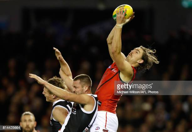 Joe Daniher of the Bombers marks the ball over Jarryn Geary of the Saints during the 2017 AFL round 17 match between the St Kilda Saints and the...