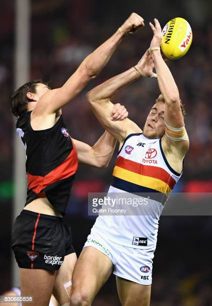 Joe Daniher of the Bombers spoils a mark by Hugh Greenwood of the Crows during the round 21 AFL match between the Essendon Bombers and the Adelaide...