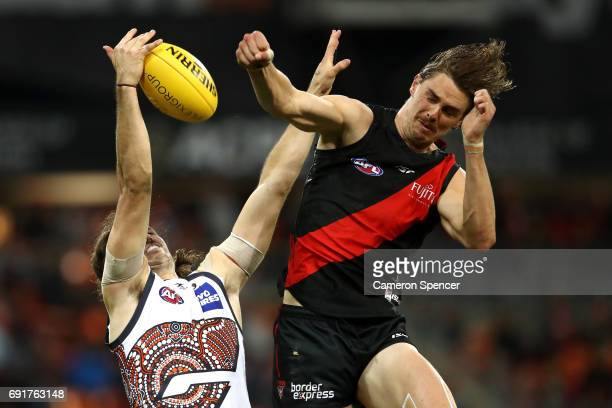 Joe Daniher of the Bombers spoils the ball over Phil Davis of the Giants during the round 11 AFL match between the Greater Western Sydney Giants and...