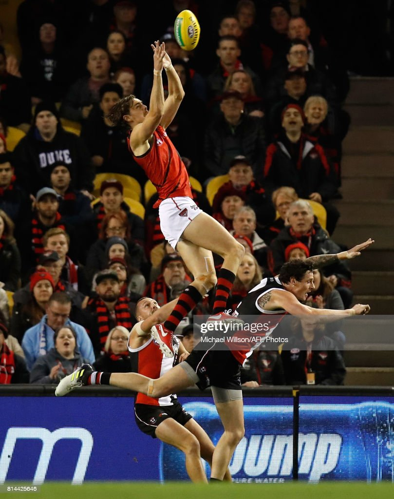 Joe Daniher of the Bombers takes a spectacular mark over Jake Carlisle of the Saints during the 2017 AFL round 17 match between the St Kilda Saints and the Essendon Bombers at Etihad Stadium on July 14, 2017 in Melbourne, Australia.